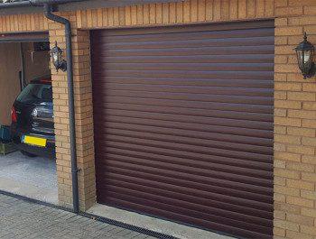 Роллетные ворота или секционные — что выбрать для гаража